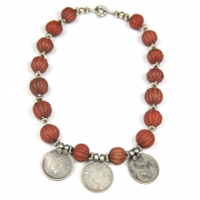 A necklace comprising Indian melon shaped jasper beads, silver spacers and three George VI rupee coin pendants.