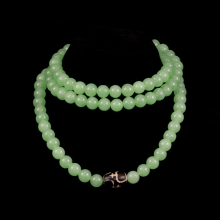 Sino-Tibetan green-stone mala with central dzi bead