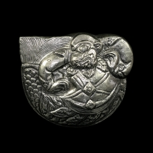 A Cambodian silver box embossed with the Hindu God Hanuman