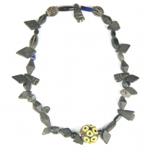 A Roman-Egyptian glass and stone bead necklace featuring a large central glass eye bead.