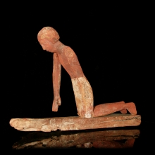 An Egyptian wooden votive model with figure of a workman, Old Kingdom