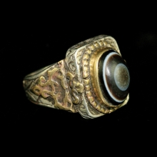 Persian silver and brass ring with agate eye bead bezel