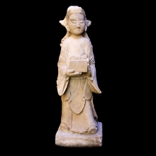 A Ming Dynasty sandstone court figure bearing a gift