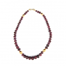 A necklace comprising Indian natural ruby round beads with 22 carat gold elements