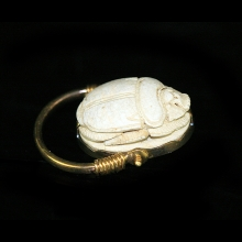 A New Kingdom royal Scarab for Thutmose III set in 18 carat gold swivel ring.
