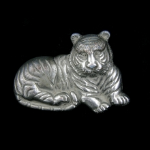 A Mongolian silver alloy belt buckle in tiger form