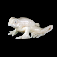 An Eskimo Inuit fossil walrus ivory carving depicting a frog.