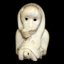 Japanese ivory Netsuke carving of a monkey riding on a tortoise, Edo