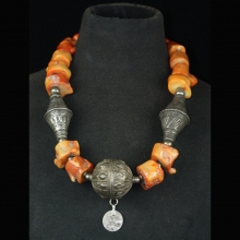 A bead necklace comprising Yemeni silver and coral  beads