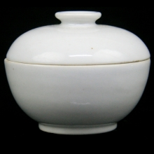 A late Qing white porcelain lidded tea cup.