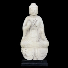 A Ming to Qing Dynasty marble figure of the seated Buddha