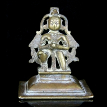 An Indian brass figure of Garuda