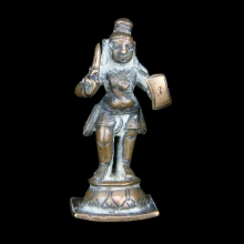 An Indian copper figure of Krishna