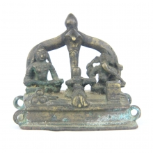 An Indian brass shrine sculpture of Agni holding a ghee ladle seated next to Ganesh surmounted by a Naga