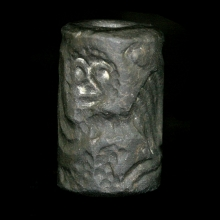 A Bactrian black stone cylinder seal engraved with a pair of lions facing each other