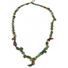 A glass paste bead necklace comprising beads of various forms from the Greek to early Islamic periods