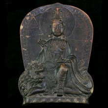 A Chinese clay plaque of the Goddess Tara seated atop a lion