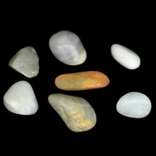 A group of seven (7) provincial jade river pebbles of various forms