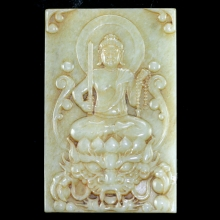A Chinese mid 20th century green jade plaque depicting Acala