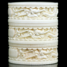 A group of three Qing to Republic carved ivory napkin rings with dragon motif.