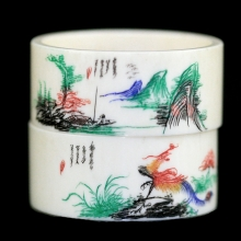A group of two Qing to Republic ivory napkin rings painted with phoenix and mountain designs