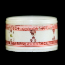 A Pre-Ban Indian carved ivory napkin ring with polychorme decoration.