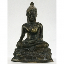 A Thai bronze figure of the seated Buddha.