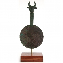 A Central Asian bronze mirror with figurative handle in the form of a Bull