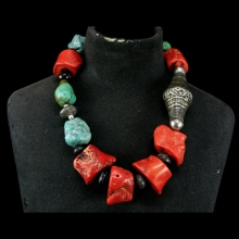 A Tibetan necklace comprising coral, turquoise, agate and silver