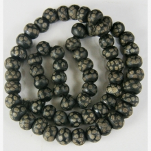 A strand of Sudanese black and white trade beads.