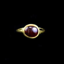 A Roman gold with garnet bezel finger ring