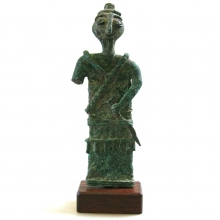A rare Luristan bronze figure of a warrior.