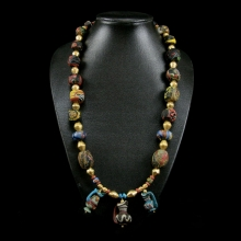 A fine Persian glass bead necklace with modern gold beads