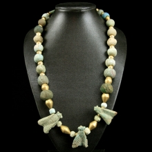 A necklace comprising Middle Kingdom faïence beads, with three Royal faience fly amulets and modern gold spacer beads