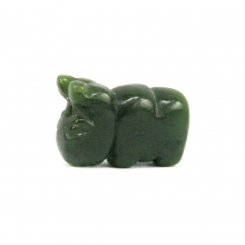 A Mongolian green jade or nephrite bead in the form of a bull