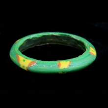 Islamic red, green and yellow glass bracelet.