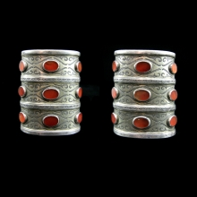 A fine pair of Turkoman Silver armlets with carnelian inlay and engraved motif